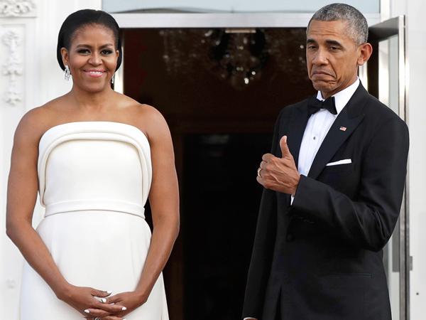 Begini Reaksi Presiden Obama Saat Terpesona dengan Penampilan Anggun Sang Istri