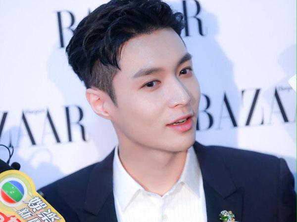 Sempat Pingsan, Lay EXO Minta Fans Jangan Salahkan SM Entertainment