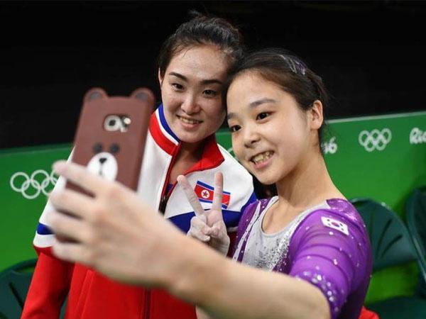 Selfie Bareng Atlet Korsel, Atlet Korut Ini Terancam Dihukum?