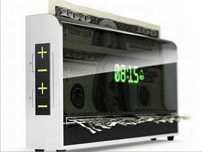 Jam Alarm Ini Akan Robek Uang Saat Berbunyi
